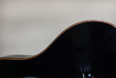 Black acoustic guitar body shape stock photos