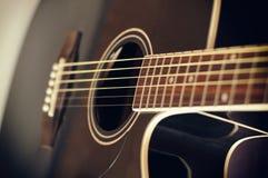 Black acoustic guitar. Details of black acoustic guitar close up Stock Image