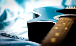 Black Acoustic Guitar in Grey Textile Close Up Photo Royalty Free Stock Photos