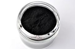Black activated charcoal powder for detox facial mask Royalty Free Stock Photo