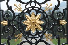 Black ad gold wrought iron gate. Classically designed black wrought iron gate with gold accents on estate in Ireland Royalty Free Stock Photography