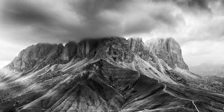 Black ad white panorama of Sassolungo mountain peaks Royalty Free Stock Photos