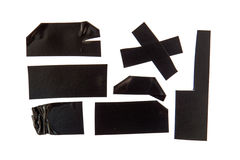 Black Adhesive Tape. Collection of used black electrical tape pieces Stock Photography