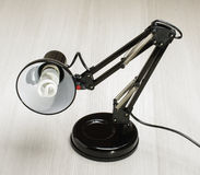 Black adjustable desk lamp on the bright background Stock Images