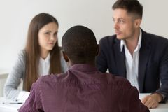Black advisor consulting doubtful partners couple during negotia stock photos