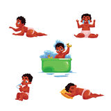 Black, African American baby kid, infant daily routine activities Stock Photos