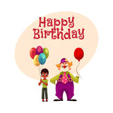 Black, African American boy holding balloons standing with funny clown Stock Images