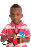 Black African American child stethoscope. Black African American child with stethoscope and car isolated metisse hair curly Royalty Free Stock Photos