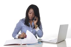 Black African American ethnicity frustrated woman working in stress at office. Black African American ethnicity woman working hard as secretary in stress talking Royalty Free Stock Photos