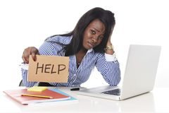 Black African American ethnicity frustrated woman working in stress at office Royalty Free Stock Photos