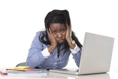 Black African American ethnicity frustrated woman working in stress at office. Black African American ethnicity tired and frustrated woman working as secretary stock image