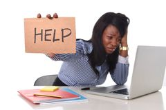 Black African American ethnicity frustrated woman working in stress at office Stock Photography
