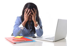 Black African American ethnicity stressed woman suffering depression at work. Black African American ethnicity depressed and frustrated woman working as Royalty Free Stock Photos
