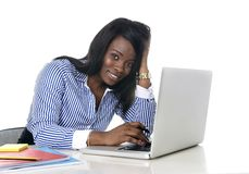 Black african american ethnicity woman working at computer laptop at office desk smiling happy Royalty Free Stock Photography