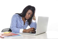 Black African American ethnicity worried woman working in stress at office. Black African American ethnicity tired and frustrated woman working as secretary in royalty free stock photo