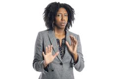 Black African American Female Business Woman Looking Scared. Black African American female businesswoman isolated on a white background looking scared and stock photography