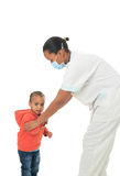 Black African American nurse with child isolated. Metisse stethoscope infirmiere Royalty Free Stock Photos