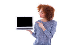 Black African American student girl holding a laptop and pointin Stock Photos