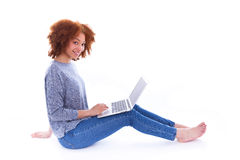 Black African American student girl using a laptop Royalty Free Stock Photos
