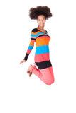 Black African American teenage girl with a afro haircut jumping Stock Images