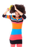 Black African American teenage girl combing her afro hair Stock Photos