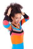 Black African American teenage girl holding her afro hair. Isolated on white background stock image