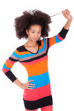 Black African American teenage girl holding her afro hair. Isolated on white background stock photography