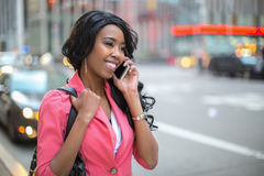 Black African American woman talking cellphone in city Royalty Free Stock Photo