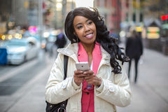 Black African American woman texting cellphone in city Royalty Free Stock Photo
