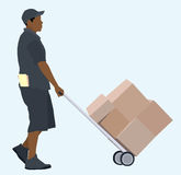 Black or African Delivery Man. African or Black delivery man with hand truck Royalty Free Stock Images