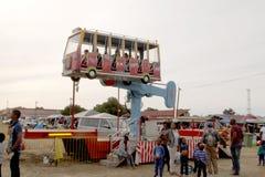 Black African families enjoying electronic rocker rides Royalty Free Stock Photo