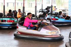 Black African girl enjoying bumper cars Stock Photos