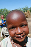 Black African Maasai tribe smiling child, close-up. Royalty Free Stock Photo
