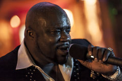 Black african male singing live. African male singer giving a live soul singing performance Stock Image