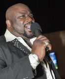 Black african male singing live. African male singer giving a live soul singing performance Royalty Free Stock Photos