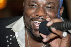 Black african male singing live. African male singer giving a live soul singing performance Royalty Free Stock Photography