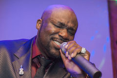 Black African male singing live. African male singer giving a live soul singing performance Royalty Free Stock Photo