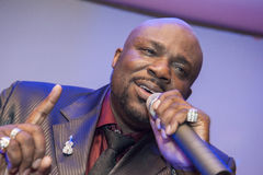 Black African male singing live. African male singer giving a live soul singing performance Royalty Free Stock Image