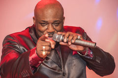 Black African male singing live. African male singer giving a live soul singing performance Royalty Free Stock Images