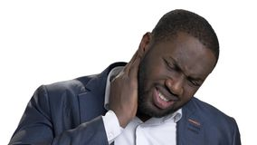 Black african man with bad neck pain, after long hours of work. Isolated white background. Negative human emotions, facial expressions stock footage