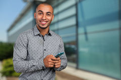 Black african man with cell phone Royalty Free Stock Photo