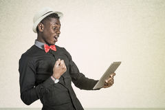 Black African with Tablet. Black African American College Student Working on Touch Screen Tablet Royalty Free Stock Image