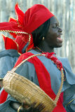 Black african woman. Traditional dressed black woman with basket during walking parade Stock Photo