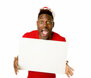 Black afro american man in Christmas Santa hat smiling happy showing blank billboard copy space Royalty Free Stock Image