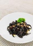 Black aglio olio pasta Stock Photo