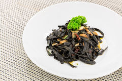 Black aglio olio pasta Stock Photo