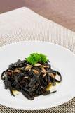 Black aglio olio pasta. Fresh black aglio olio pasta with garlic and chilli Stock Images