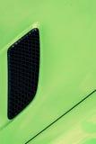 Black air intake grid  of green sport turbo car Royalty Free Stock Photo
