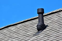 Black air ventilation chimney on roof stock photo