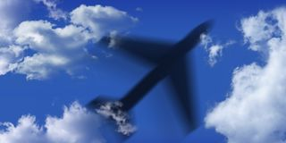 Black airplane and blue sky and clouds Stock Photography